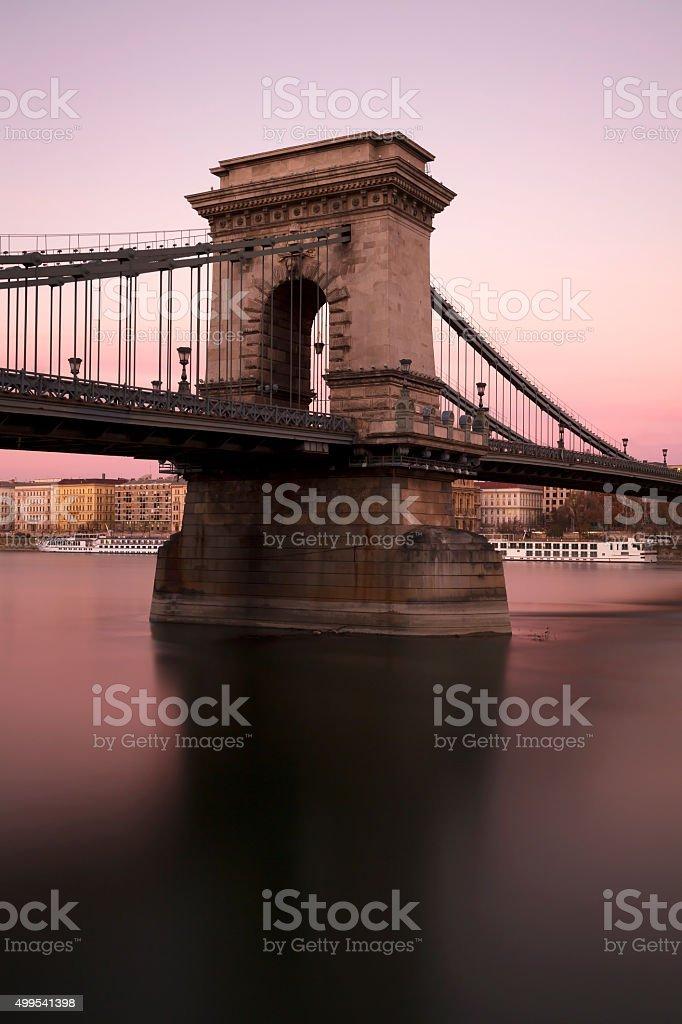 Pillar of Chain Bridge in Budapest at sunset stock photo