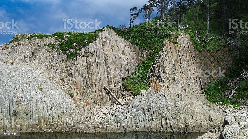 Pillar Rocks of Stolbchatiy cape in Kunashir, Kuril islands Russia stock photo