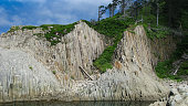 Pillar Rocks of Stolbchatiy cape in Kunashir, Kuril islands Russia