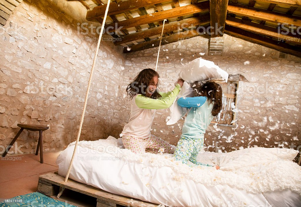 Pillow  fight in bedroom stock photo