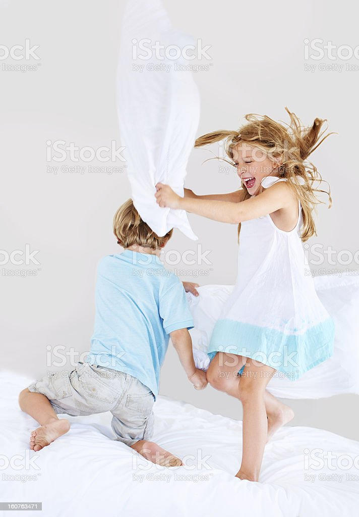 Pillow fight! stock photo