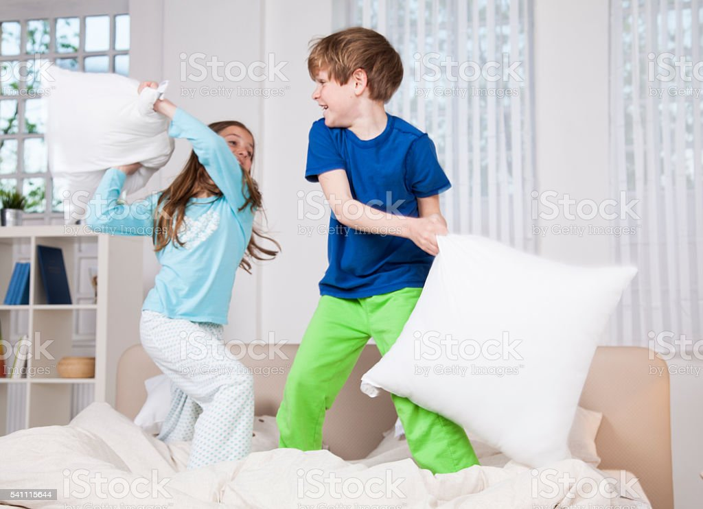 Pillow fight! stock photo