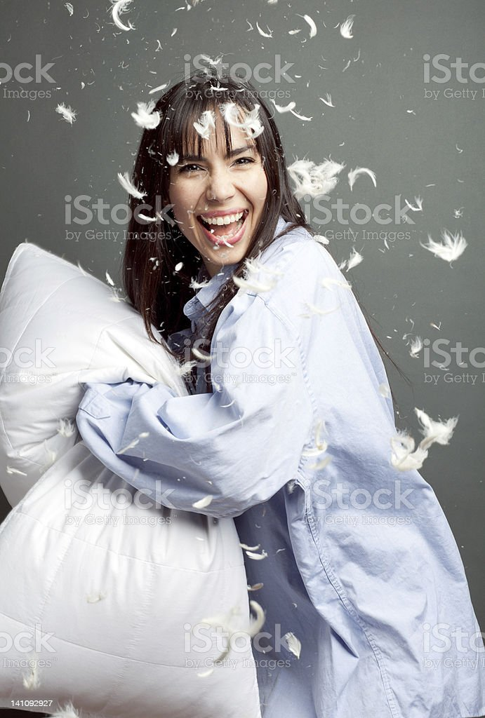 Pillow Fight with Happy Woman stock photo