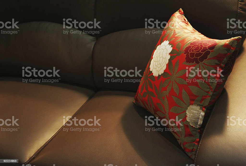 Pillow on a leather sofa royalty-free stock photo