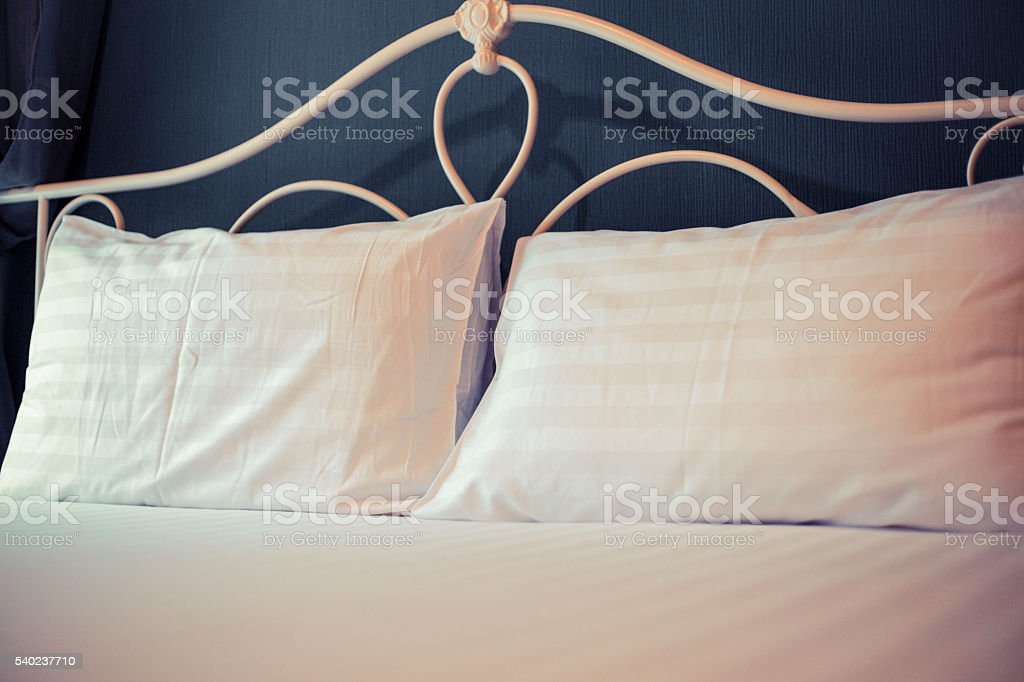 Pillow on hotel bed stock photo