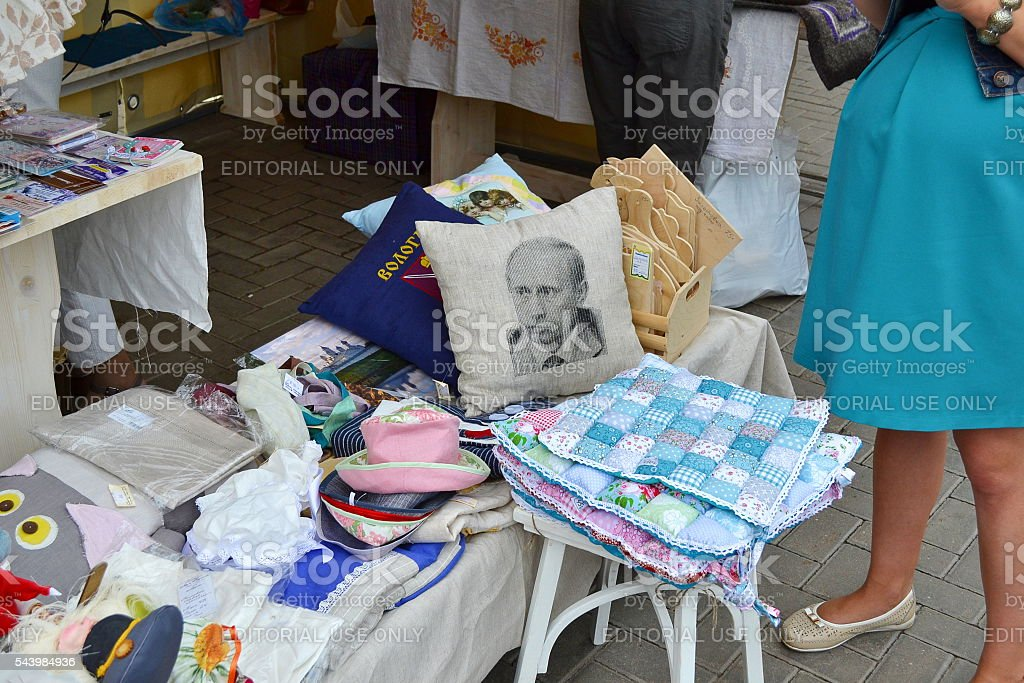 Pillow, Putin's image, festival, trade objects, people, Vologda, Russia. stock photo
