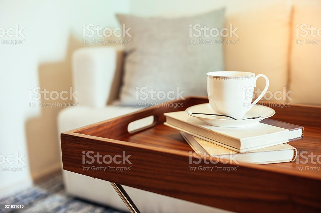 Pillow Sofa Home Interior Coffee cup Books on wooden table stock photo