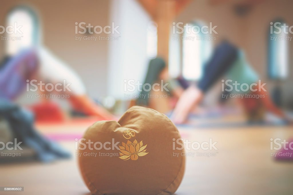 Pillow with Om symbol stock photo
