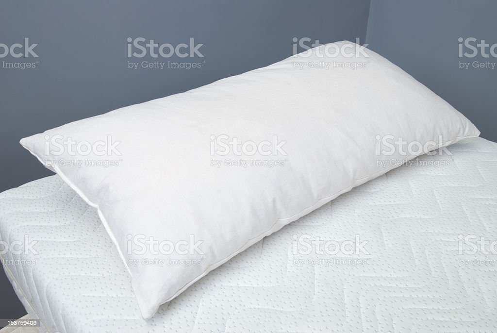 pillow with RHOMBO FILL on mattress royalty-free stock photo