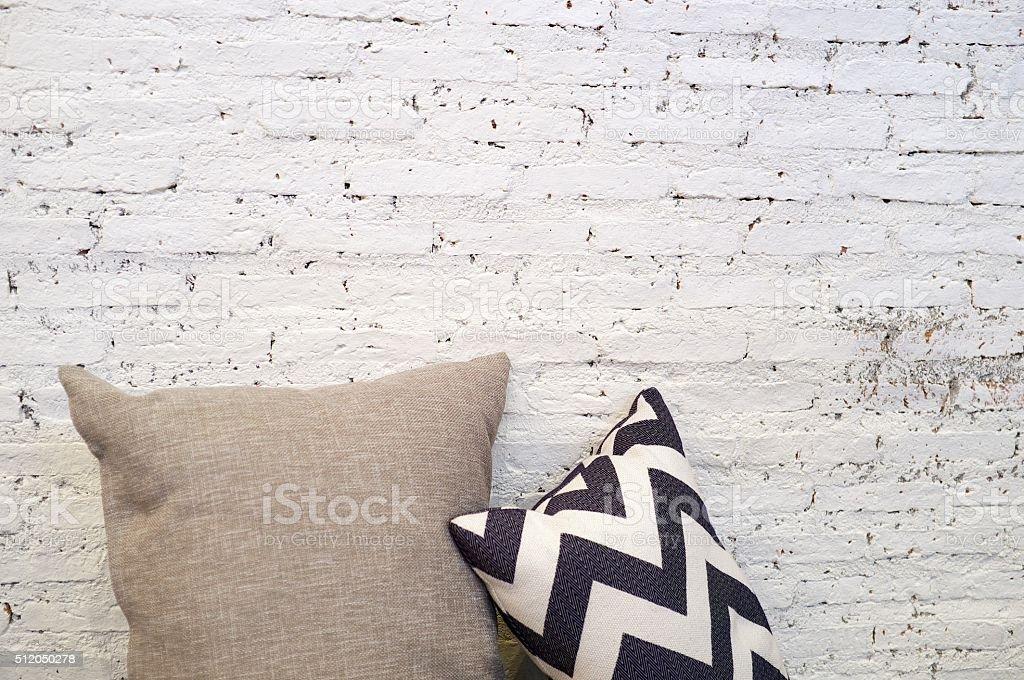 Pillow with white brick wall stock photo