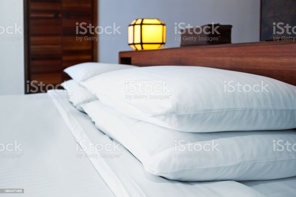 pillows arranged on bed stock photo