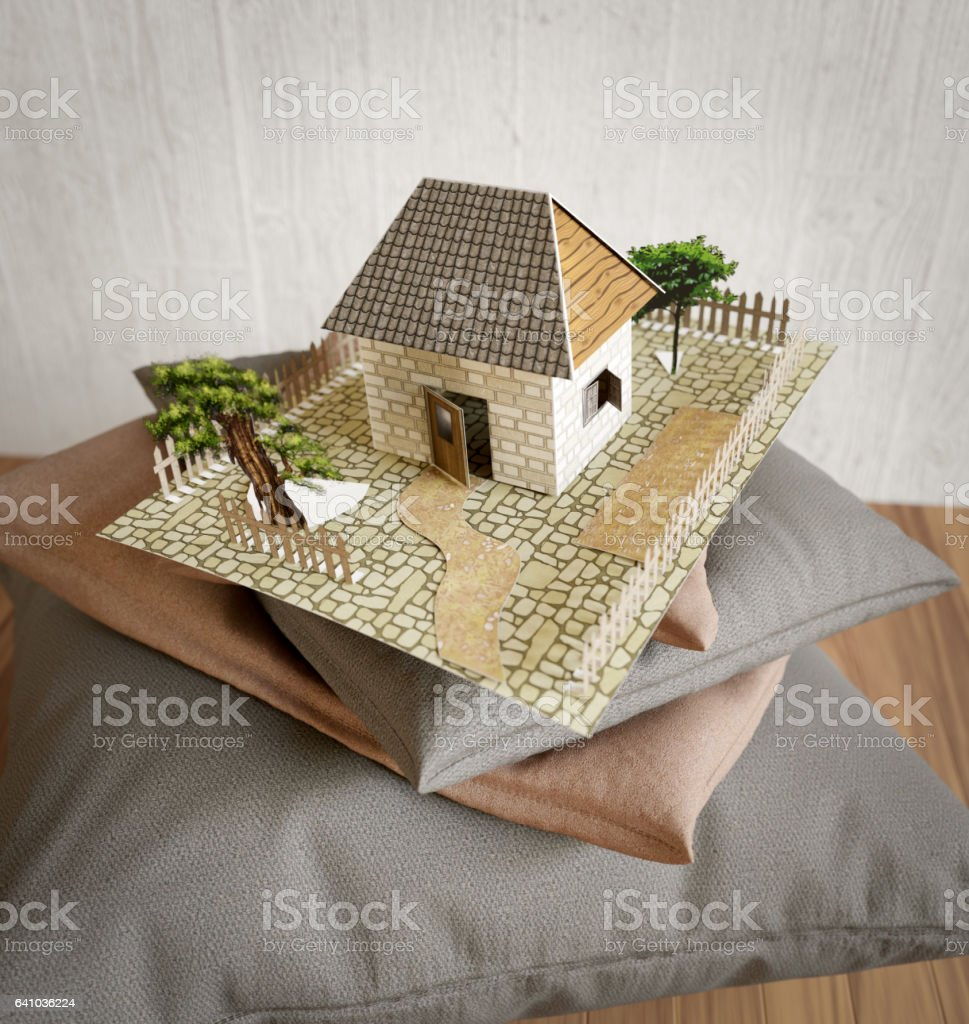 pillows collection and toy house from paper concept composition stock photo