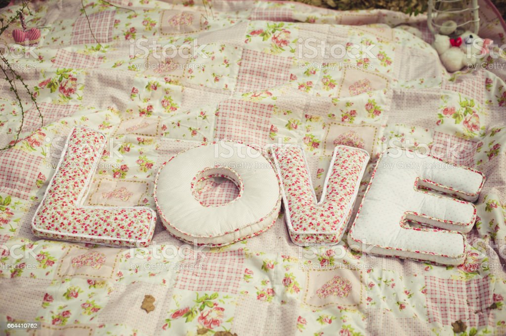 Pillows in the form of letters Love on a blanket. stock photo