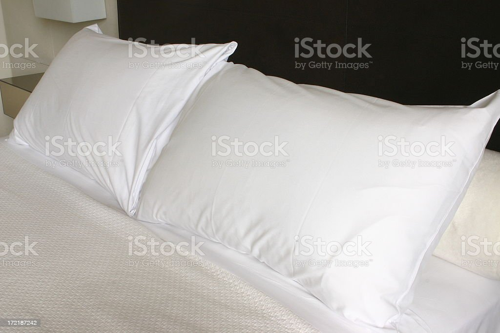 pillows on a hotel room bed royalty-free stock photo