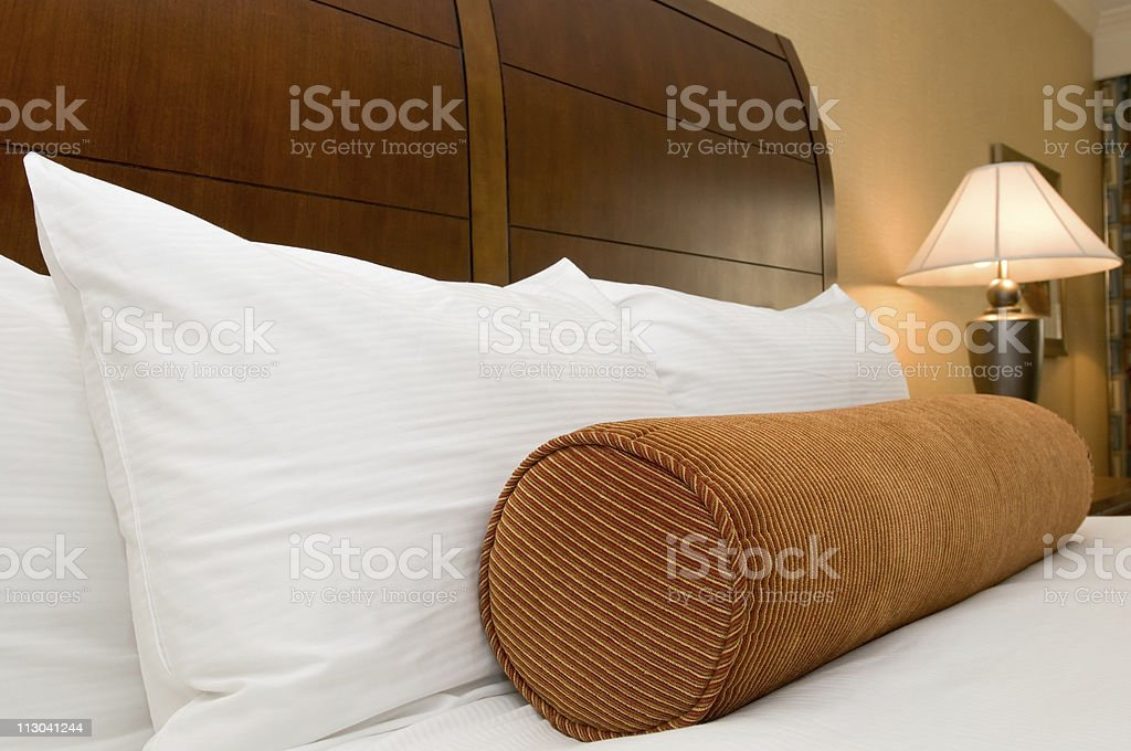 Pillows on bed in hotel room royalty-free stock photo