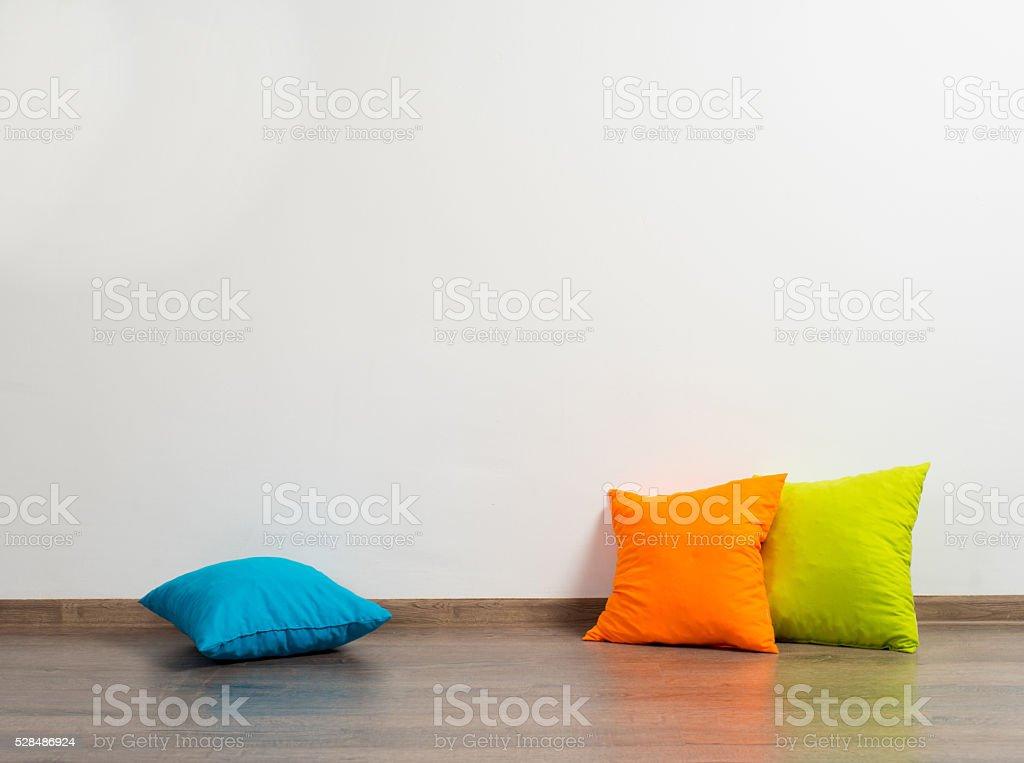 Pillows on floor stock photo