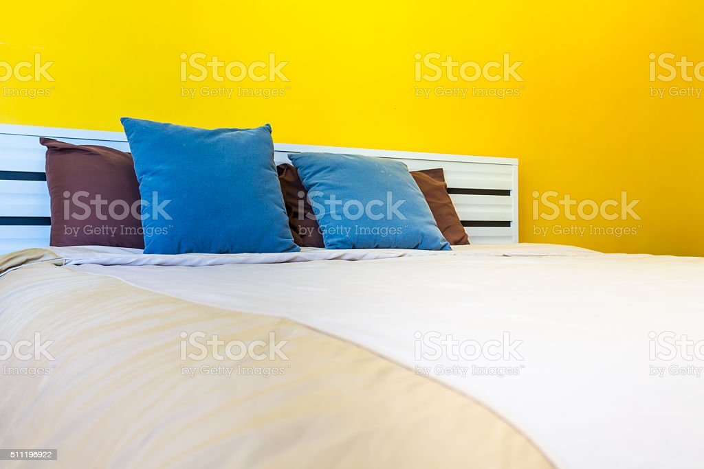 Pillows Sheets and colorful Wallpaper. stock photo