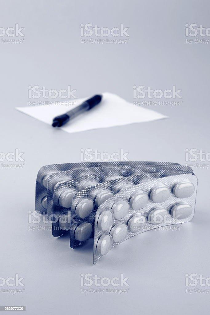 Pills along with prescription stock photo