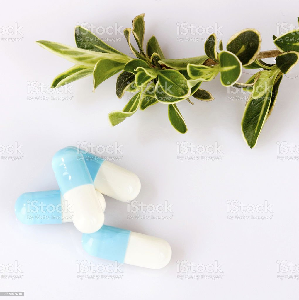 pills an pill bottle on white background royalty-free stock photo