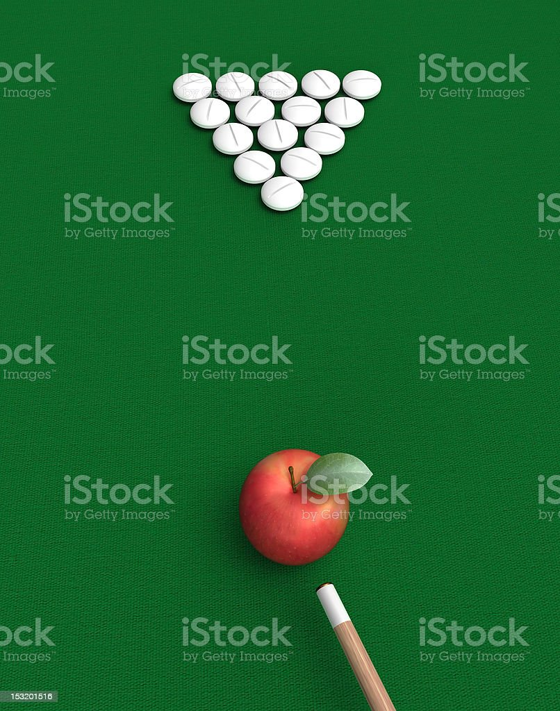 pills and apple on billiard table royalty-free stock photo