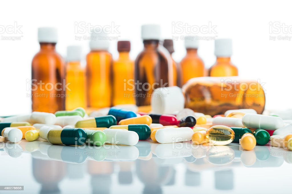 Pills and capsule isolated stock photo