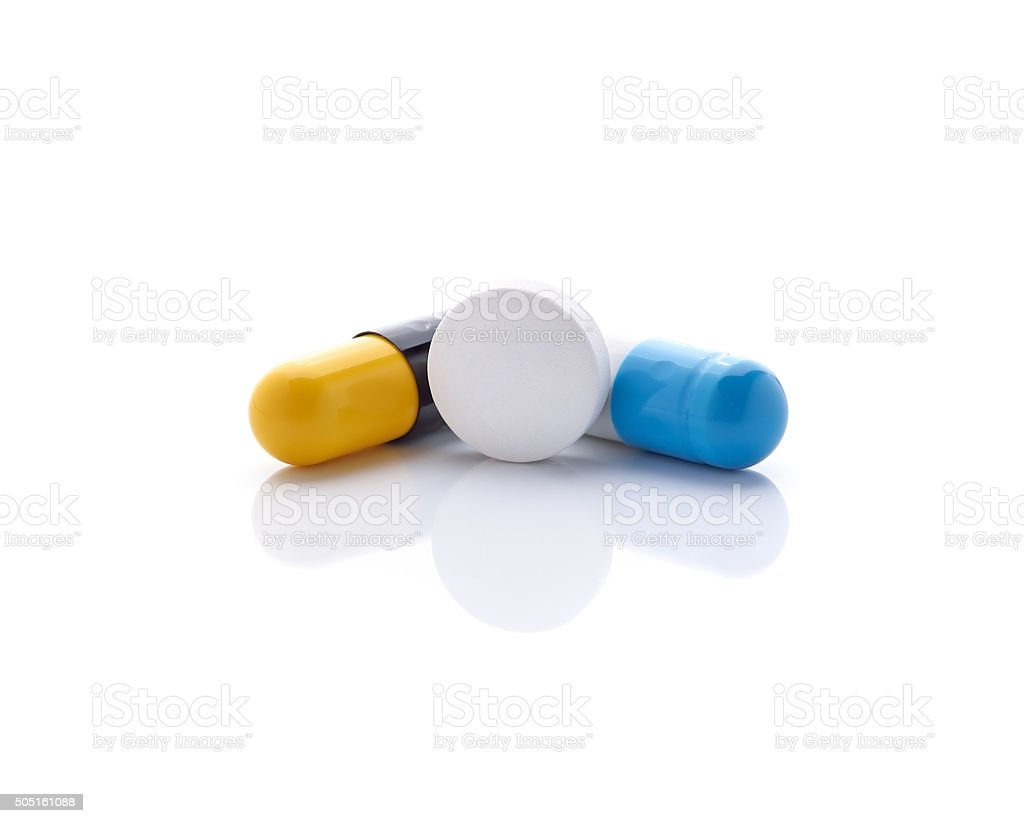 pills and capsules isolated on white background stock photo