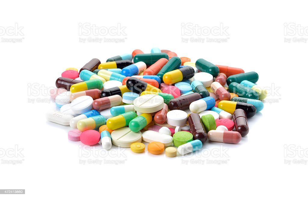 pills and capsules on white background stock photo