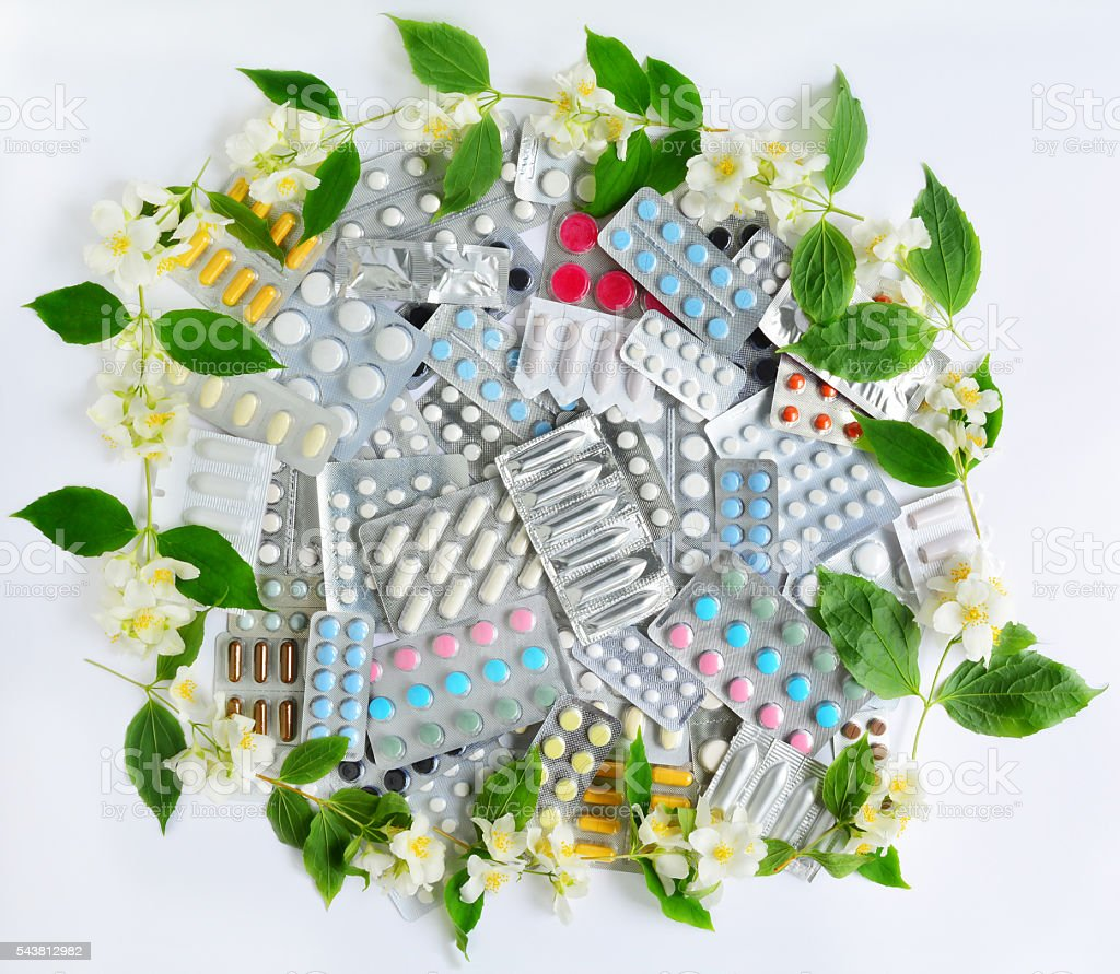 Pills and Flowers stock photo