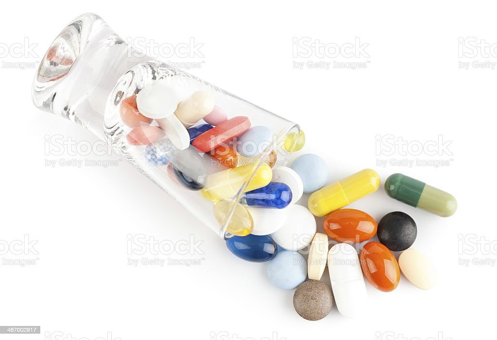 Pills and glass royalty-free stock photo