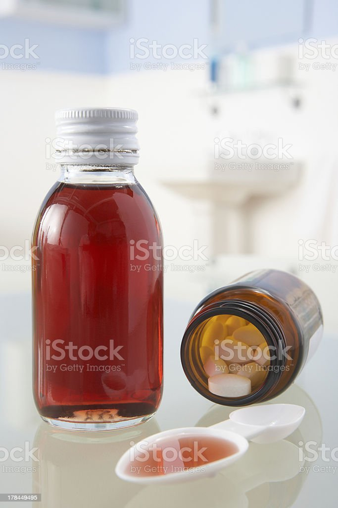Pills and medicine on bathroom shelf stock photo