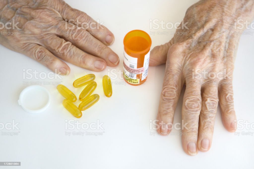 Pills and senior hands royalty-free stock photo