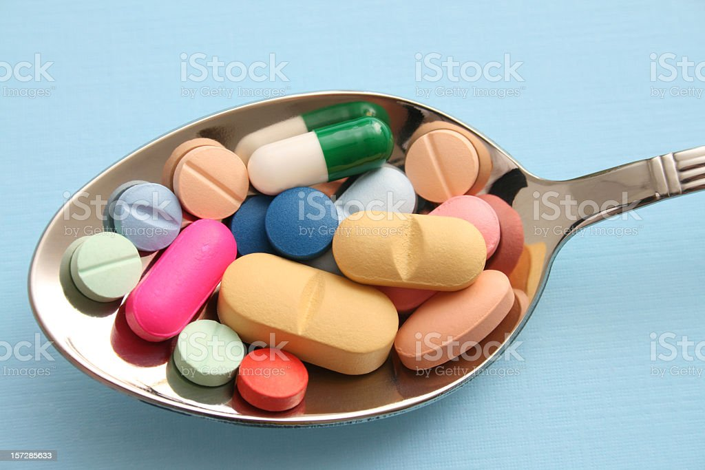 Pills and spoon royalty-free stock photo