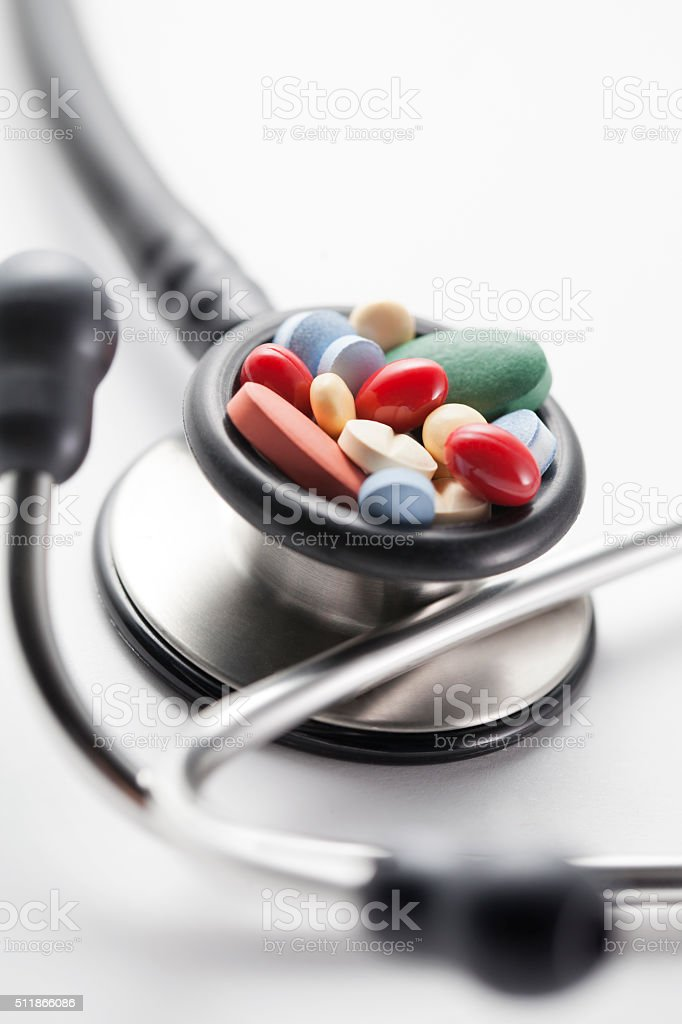 Pills and stethoscope stock photo