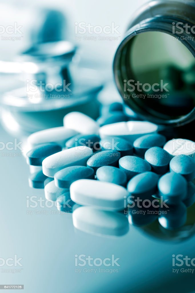 pills and stethoscope stock photo