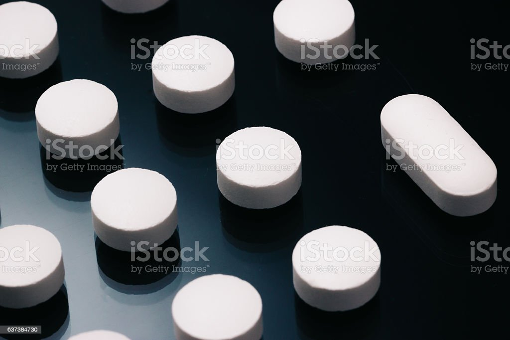 Pills Arranged and Organized with an odd shaped tablet pill stock photo