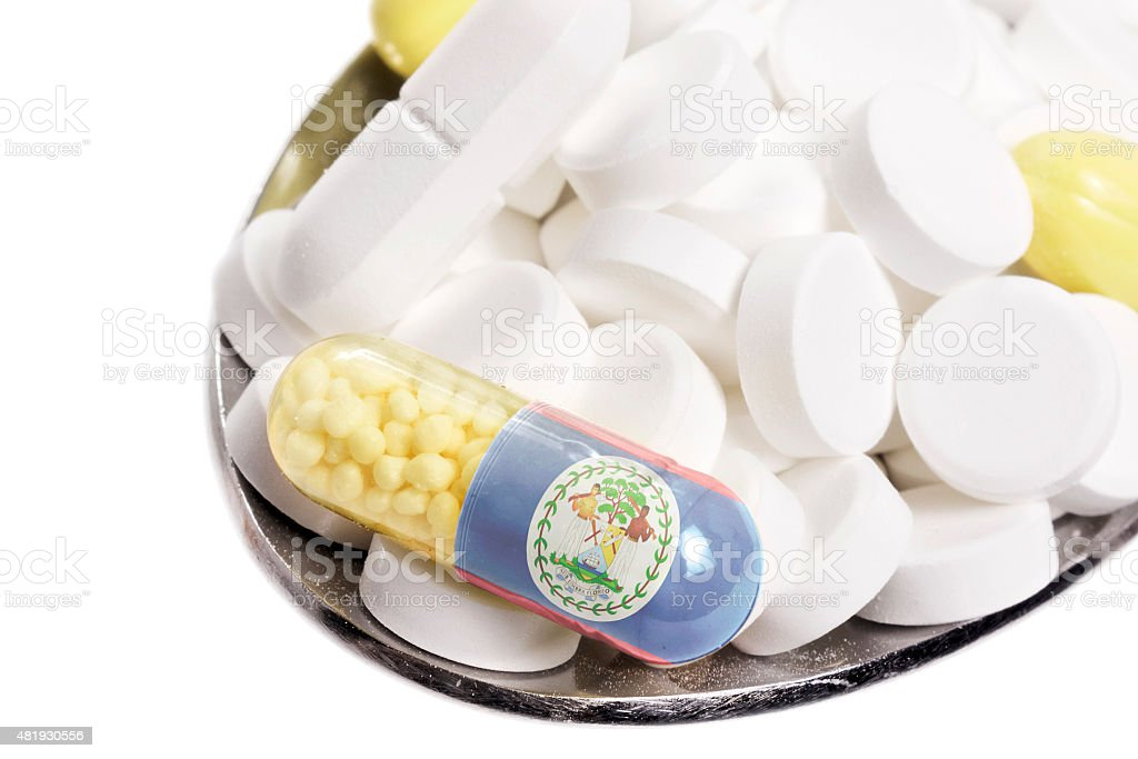 Pills & capsule with the flag of Belize.(series) stock photo