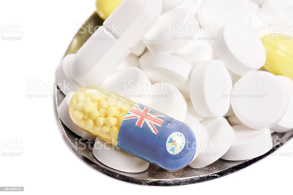 Pills & capsule with the flag of Queensland.(series) stock photo