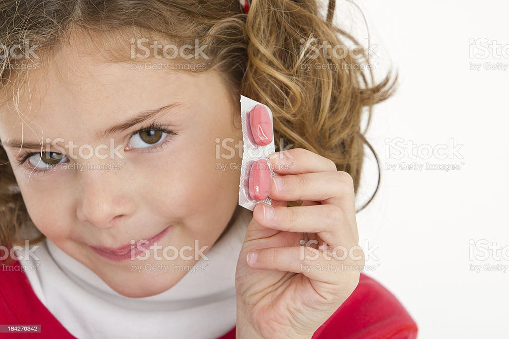 Pills for an ill little girl royalty-free stock photo