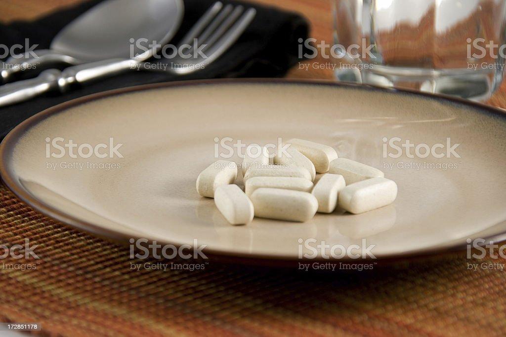 Pills for breakfast stock photo