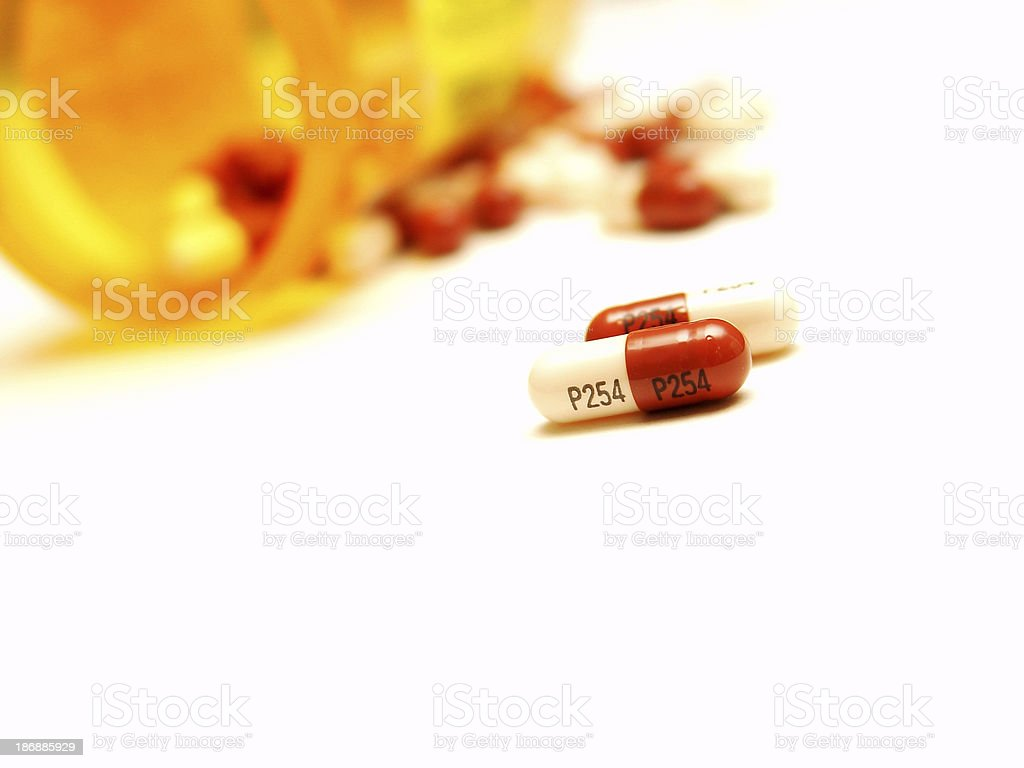 Pills from a bottle. stock photo