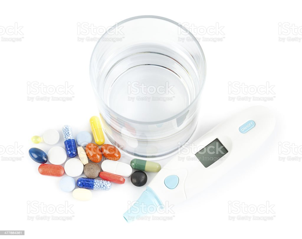 Pills glass and thermometer royalty-free stock photo