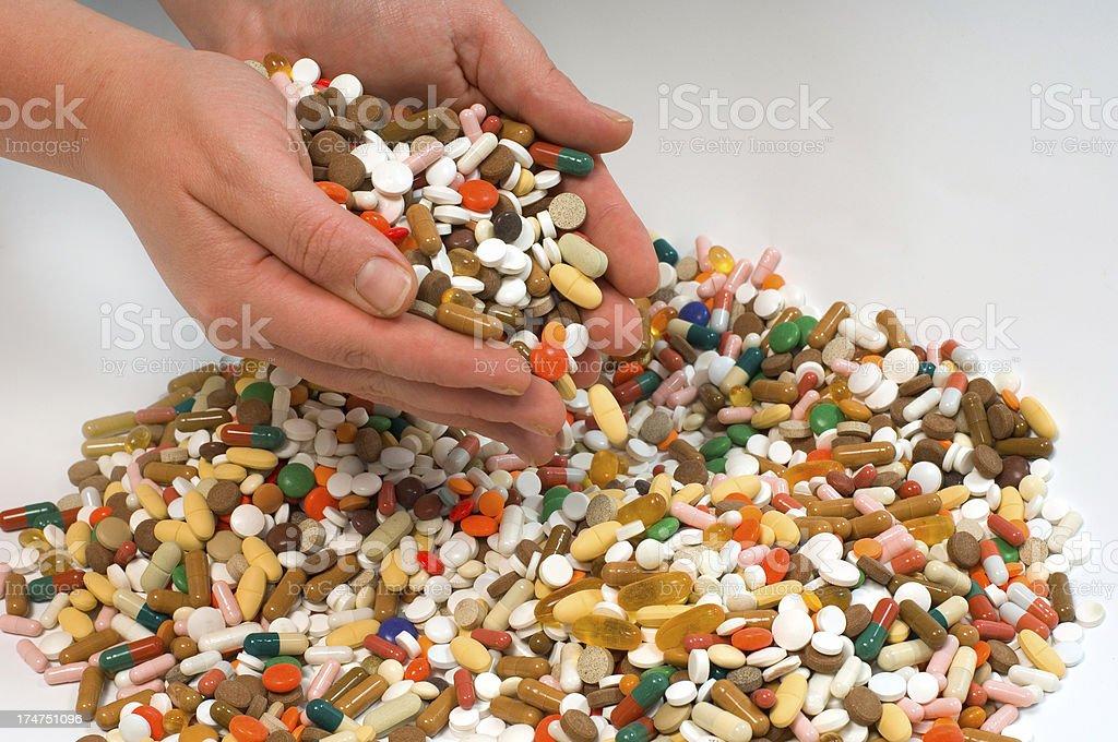 pills: hands full stock photo