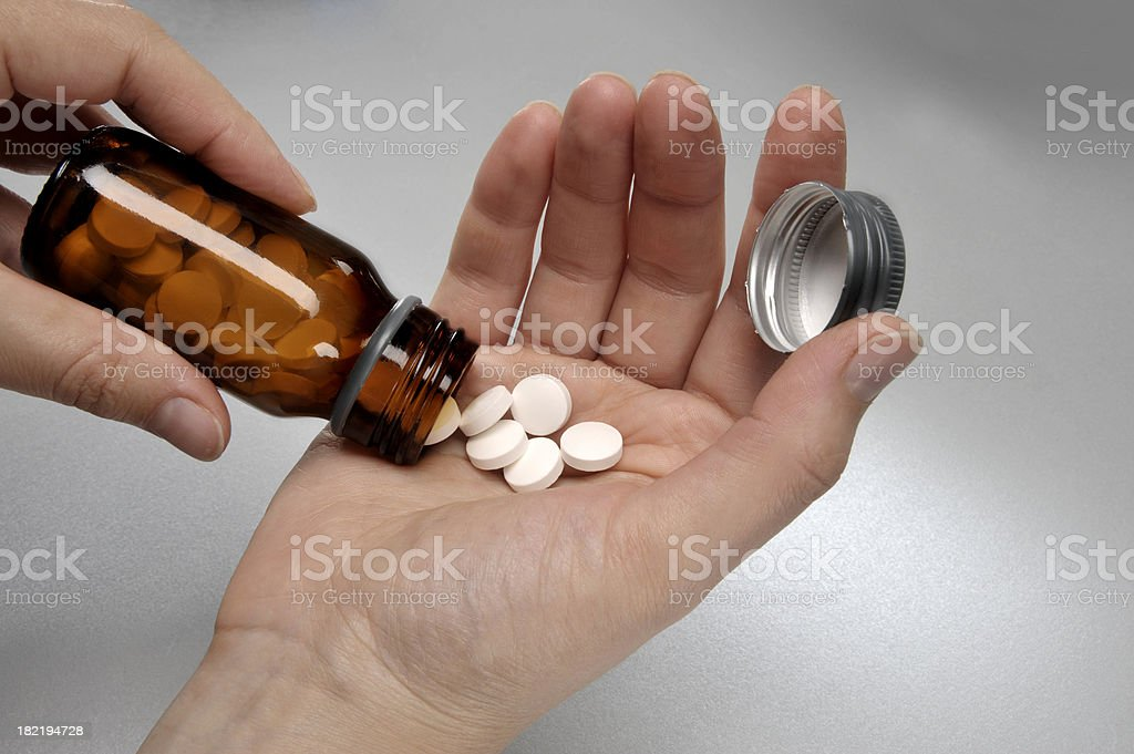 Pills in a hand royalty-free stock photo