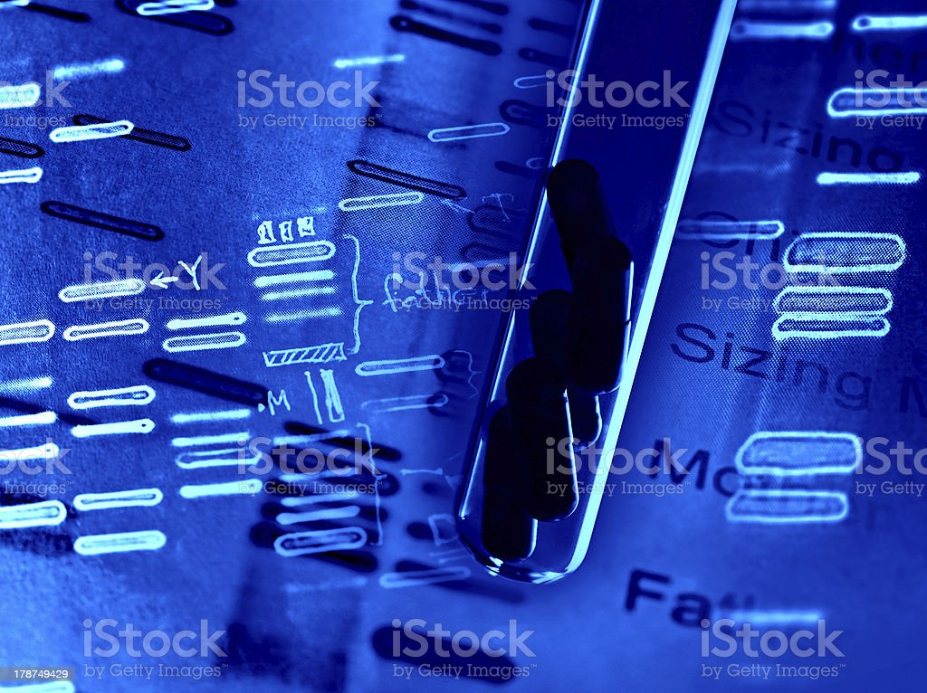 Pills in a test tube with DNA of fingerprints stock photo