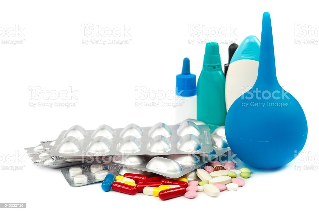 Pills in blister packs on white background. stock photo