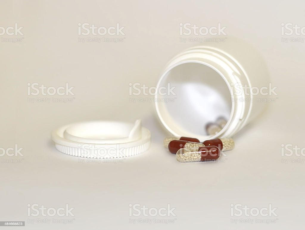 Pills in capsule on grey background stock photo