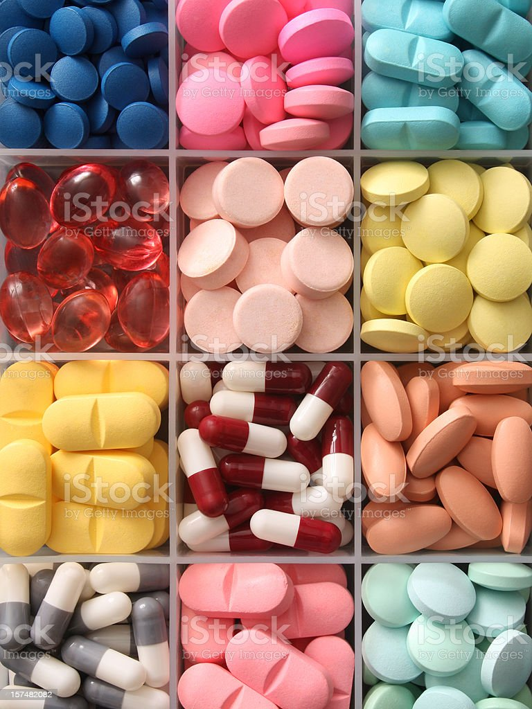 Pills in container royalty-free stock photo