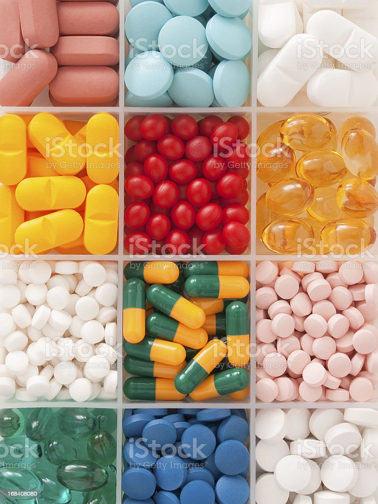 Pills in container stock photo