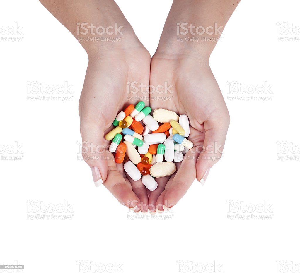 pills in female hands royalty-free stock photo