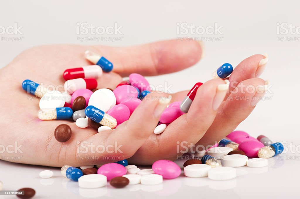 Pills in hand of a sucidal person stock photo